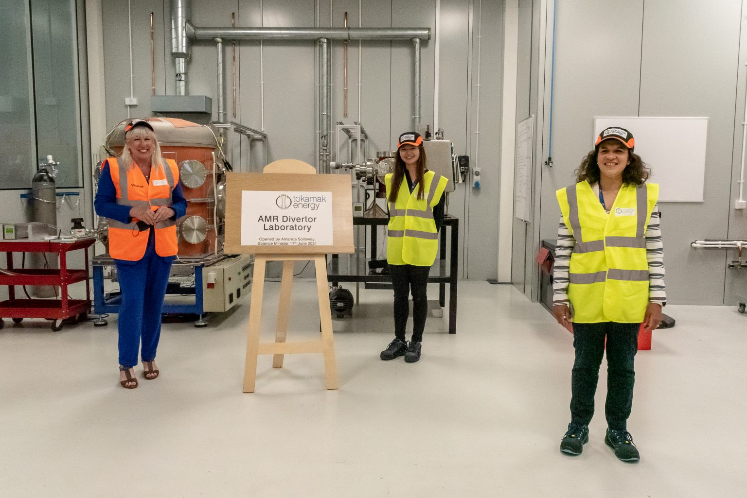 Minister for Science, Amanda Solloway MP, with Tokamak Energy's Dr Vivian Lee (Development Engineer) and Marion Hudson (AMR Programme Manager)